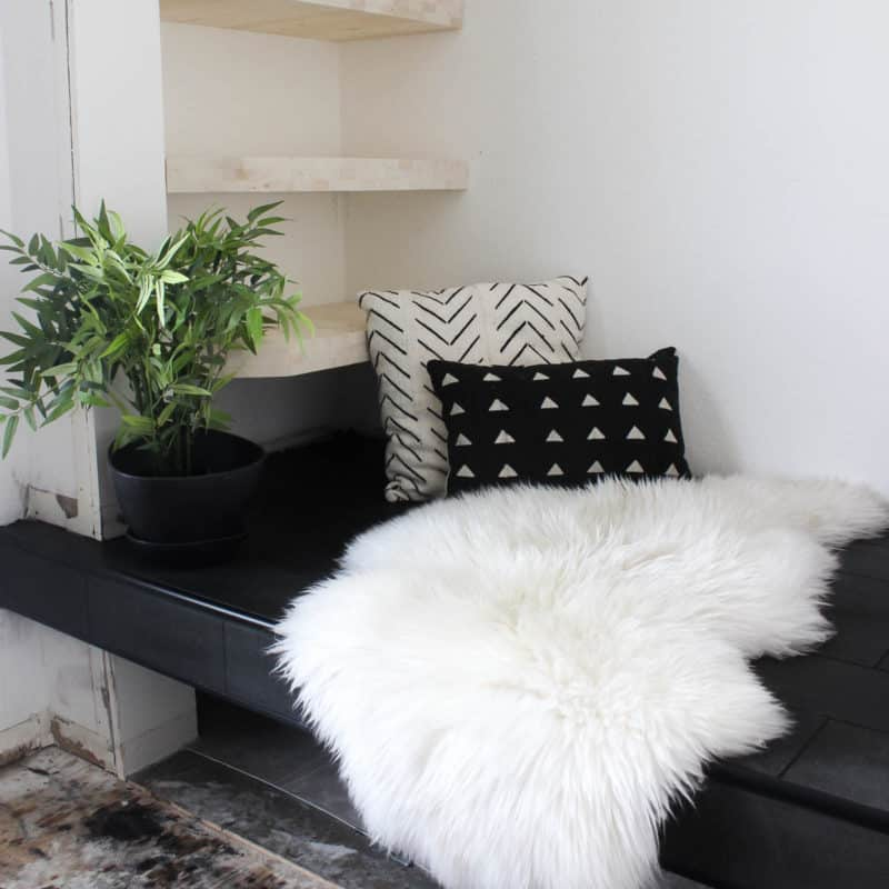 Gorgeous Tiled Entry Bench! Love the use of tile on this creative DIY project! The basalt tile looks amazing on this tiled bench seat. Great modern design for a tiled entryway!