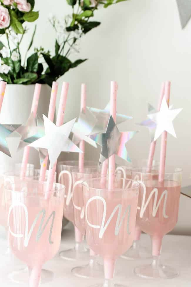 Love the personalized glasses! Beautiful Bridal Shower Decorations for the Modern Bride! Decorate with the Iridescent Martha Stewart Celebration Line, and personalize your party with the Cricut Explore 2! You're bride will be thrilled with the subtle glitter and glam in these pink and silver decorations!