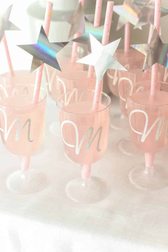 Monogrammed champagne flutes! Beautiful Bridal Shower Decorations for the Modern Bride! Decorate with the Iridescent Martha Stewart Celebration Line, and personalize your party with the Cricut Explore 2! You're bride will be thrilled with the subtle glitter and glam in these pink and silver decorations!