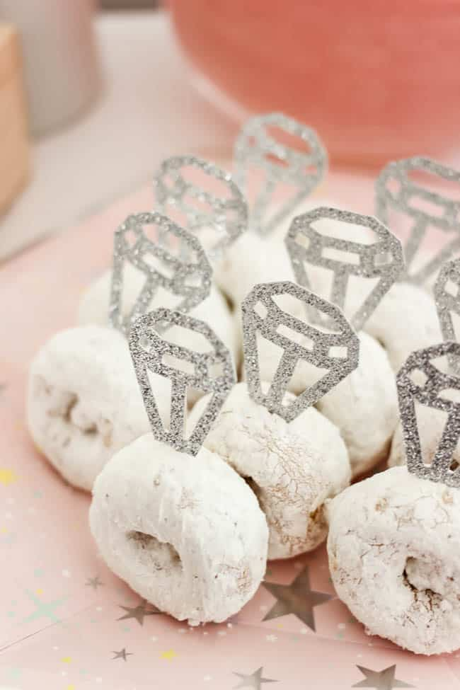 Cute donut rings! Beautiful Bridal Shower Decorations for the Modern Bride! Decorate with the Iridescent Martha Stewart Celebration Line, and personalize your party with the Cricut Explore 2! You're bride will be thrilled with the subtle glitter and glam in these pink and silver decorations!