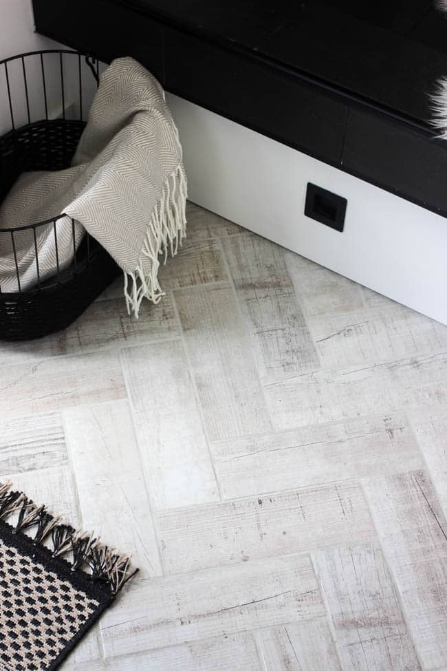This faux wood flooring tile is a touch of rustic in our otherwise modern entryway makeover