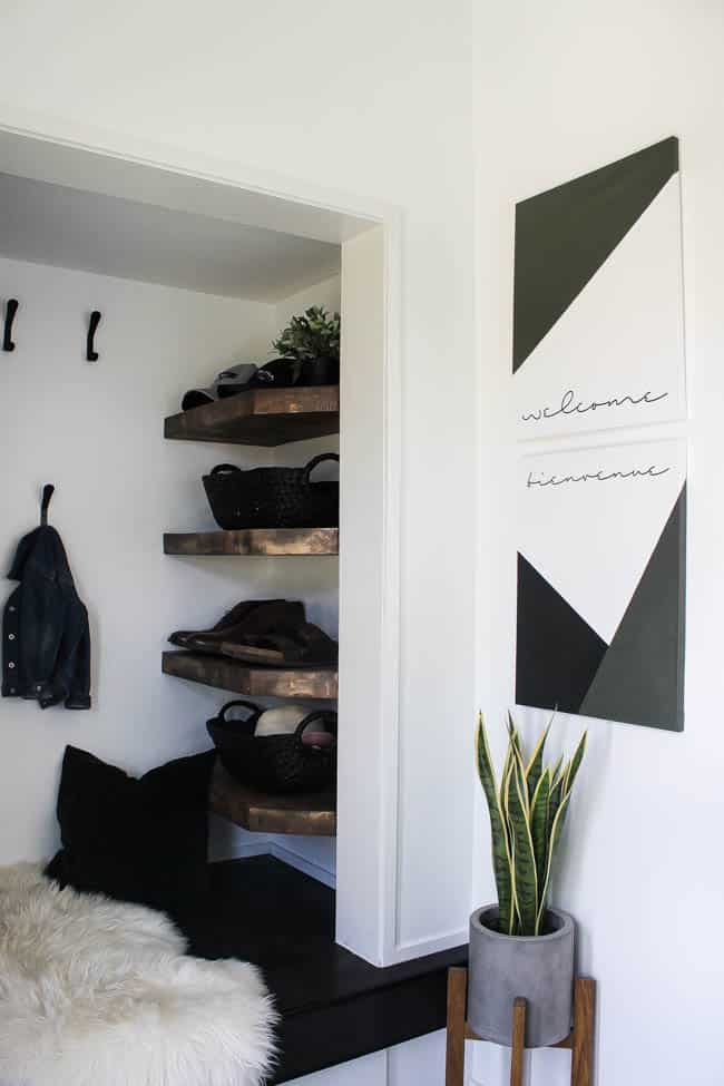 The artwork makes this modern entryway look stylish and sleek