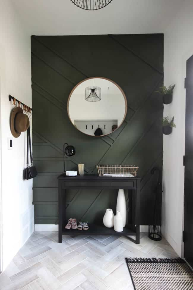 This circular mirror is the focal point on this modern style wall in our entry way
