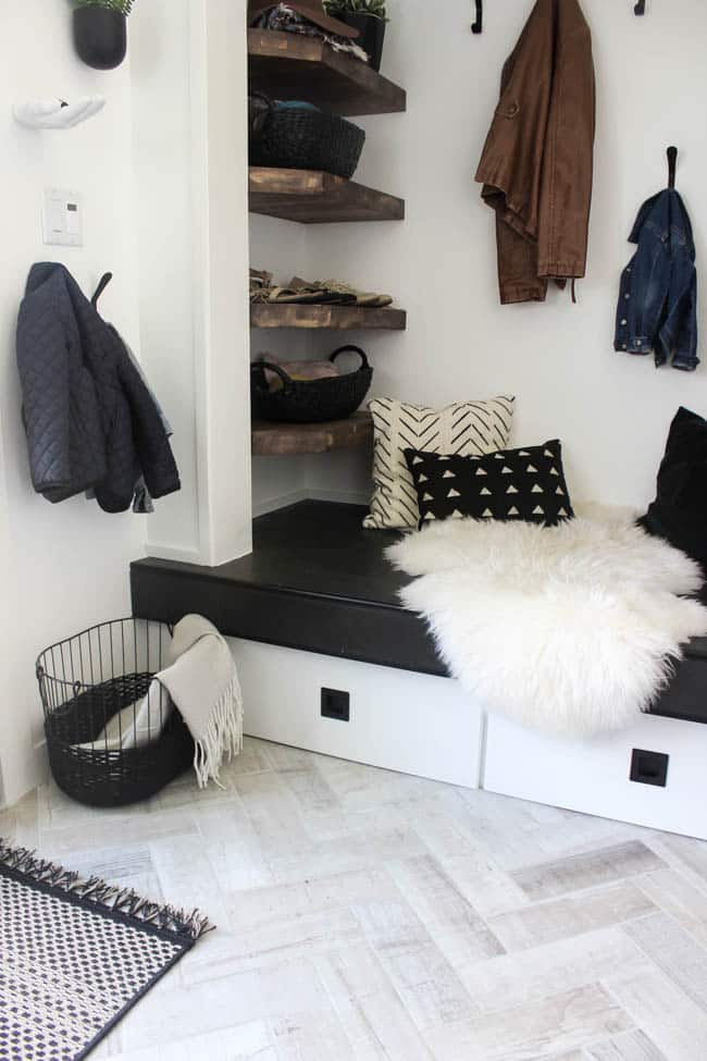 This storage nook in our redesigned modern style entry way adds a touch of rustic flair with wooden shelves