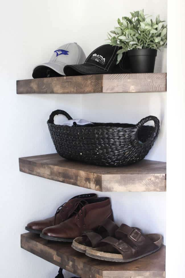 Love these rustic wood shelves in this modern style entryway