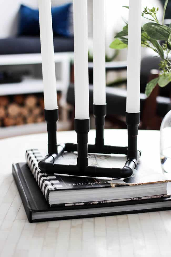 Wow! DIY candle holders have never been so easy! Such a creative use of copper pipe and spray paint! Love this easy modern decor idea! These easy candlesticks would be beautiful as centerpieces or sitting on a shelf!