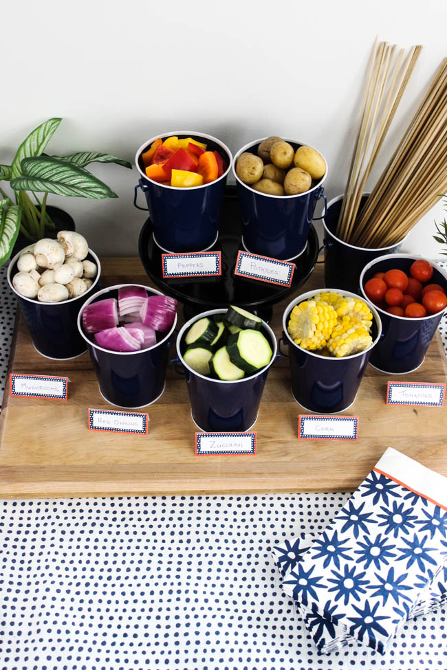 DIY Shish Kabob Bar! What an amazing idea for entertaining friends and family! Set-up your kabob bar by the BBQ and let everyone enjoy their own delicious shish kabobs.