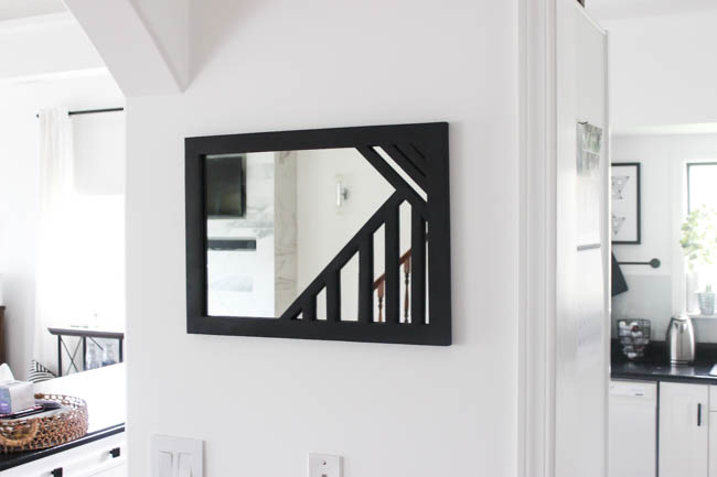 Beautiful DIY Mirror! Make your own custom framed mirrors with this simple tutorial and a Ryobi pin nailer :) Love the geometric design! The perfect wooden mirror frame for any wall!