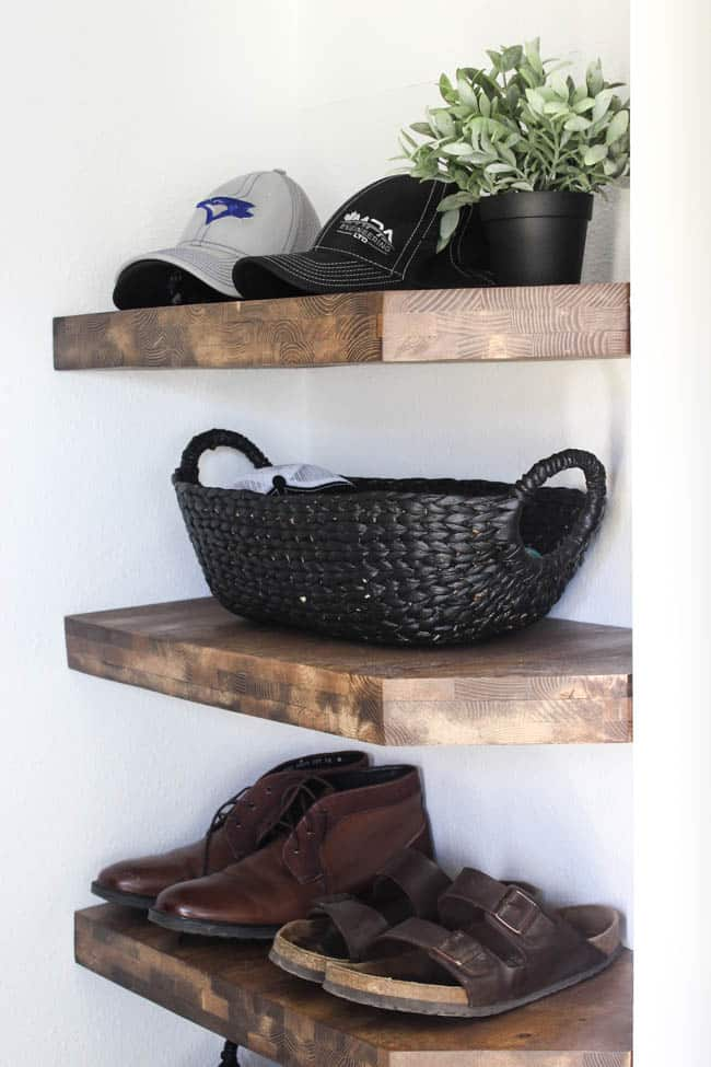 Beautiful black baskets! Make your own in five minutes by painting any old basket with the best black paint! Beautiful storage idea for this modern entry!