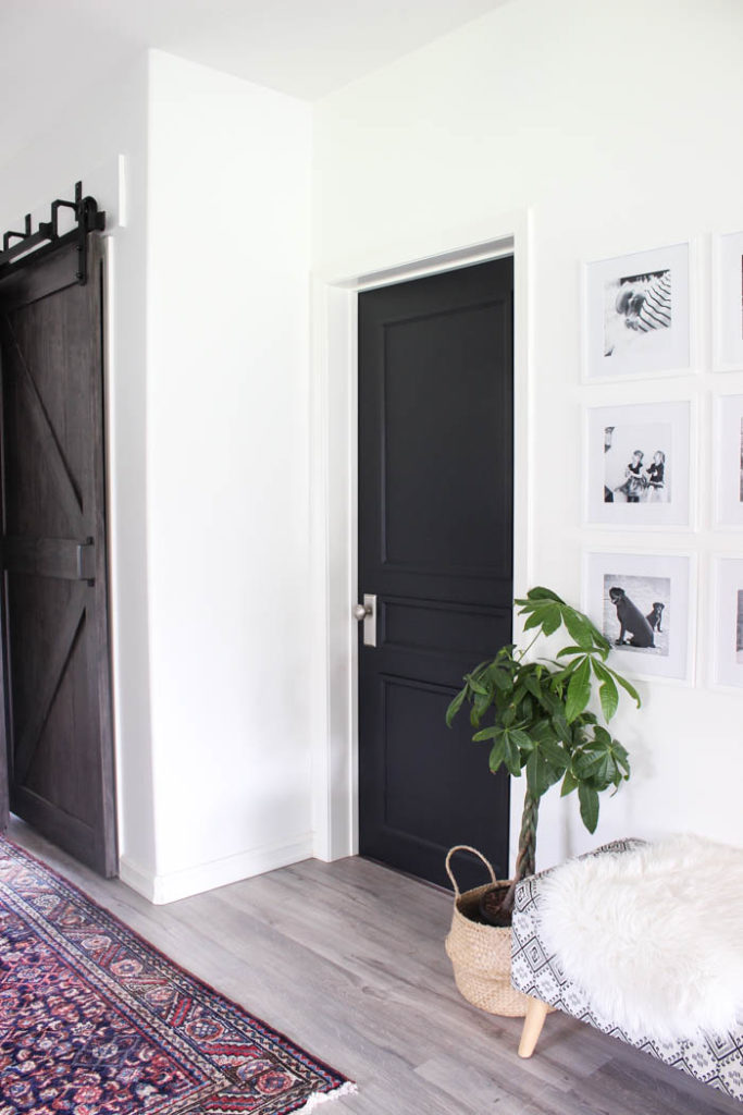 Stunning transformation! Transform outdated doors on a budget! Some trim, paint, and new hardware is all it takes to create a new modern interior door design! Love the navy blue colour on these hallway doors.