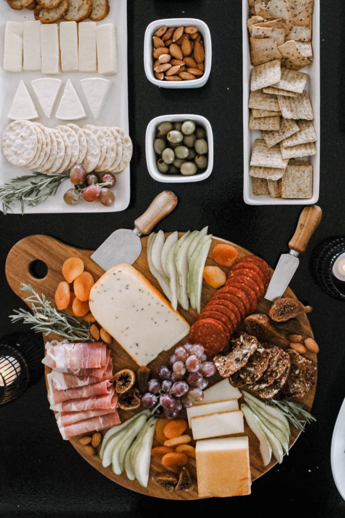 This sweet and savory spread is complete with a Fall charcuterie board, a variety of crackers and fruit.
