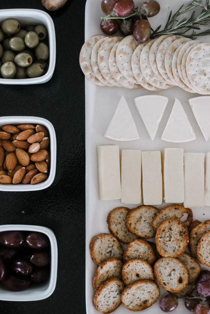 Make your fall charcuterie board easy by using prepackaged food like cheeses, nuts, and bread or cracker slices