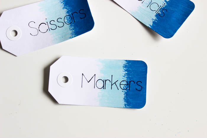 Don't like your handwriting?? Use the Cricut to write all of your tags, gift cards, envelopes! Great tutorial for showing you how to use the Cricut writing pens on materials you already have. LOVE this simple way to organize school supplies at home! The ombre tags are so cute!