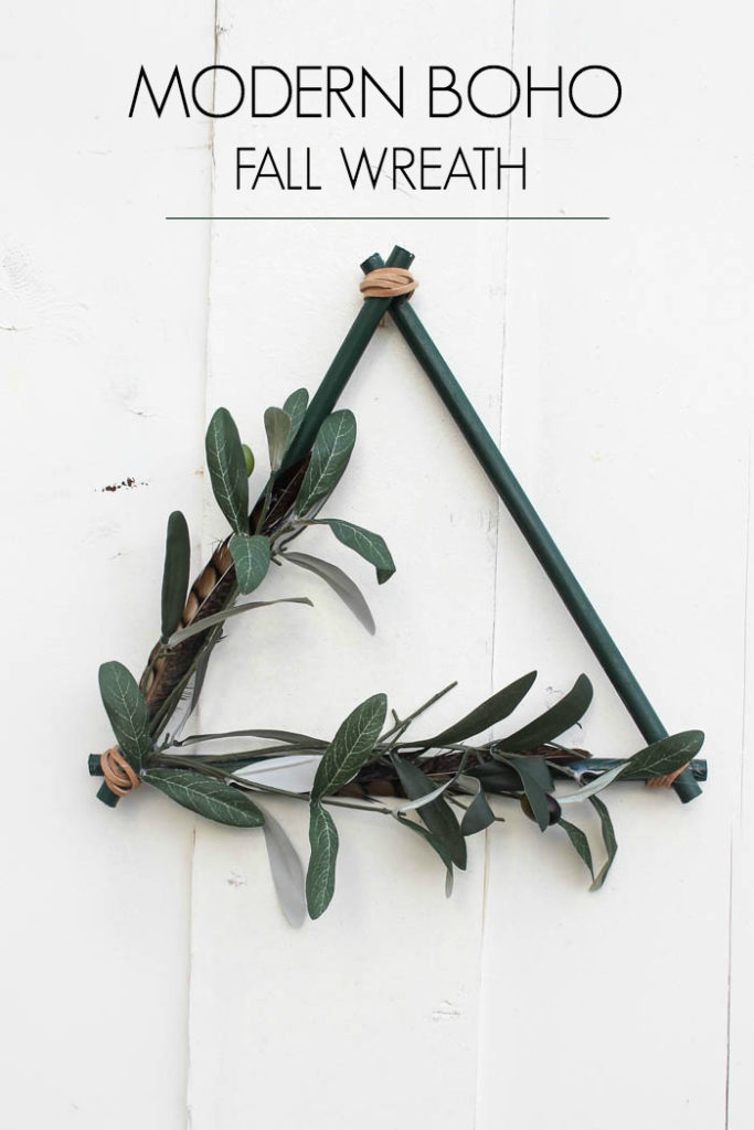 A beautiful non-traditional wreath! Love the look of this triangular modern boho wreath. Such a beautiful DIY project for the autumn season. The addition of leather, feathers, and greenery are perfect for this minimalist wreath. Beautiful greens and browns for wall!