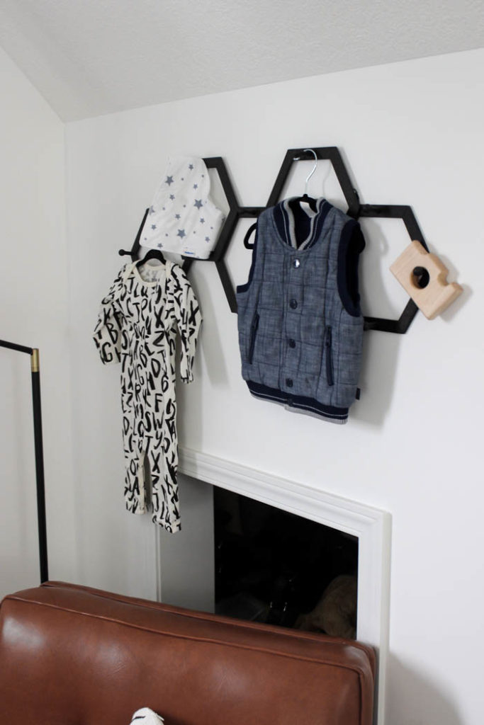 Beautiful ideas for a small modern nursery! This tiny baby room is off to the side of the master bedroom. Love the simple decor, from the navy wall to the brown crib and the beautiful gallery wall!
