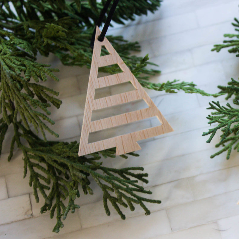 Learn how to cut wood on the Cricut Maker with this simple video tutorial! Love the beautiful holiday DIY projects! The modern stocking letters and wooden tree ornaments are the perfect Christmas DIY ideas! #Christmasornament #ornaments #DIY #Wood #Cricutmaker #ModernDesign #ModernChristmas