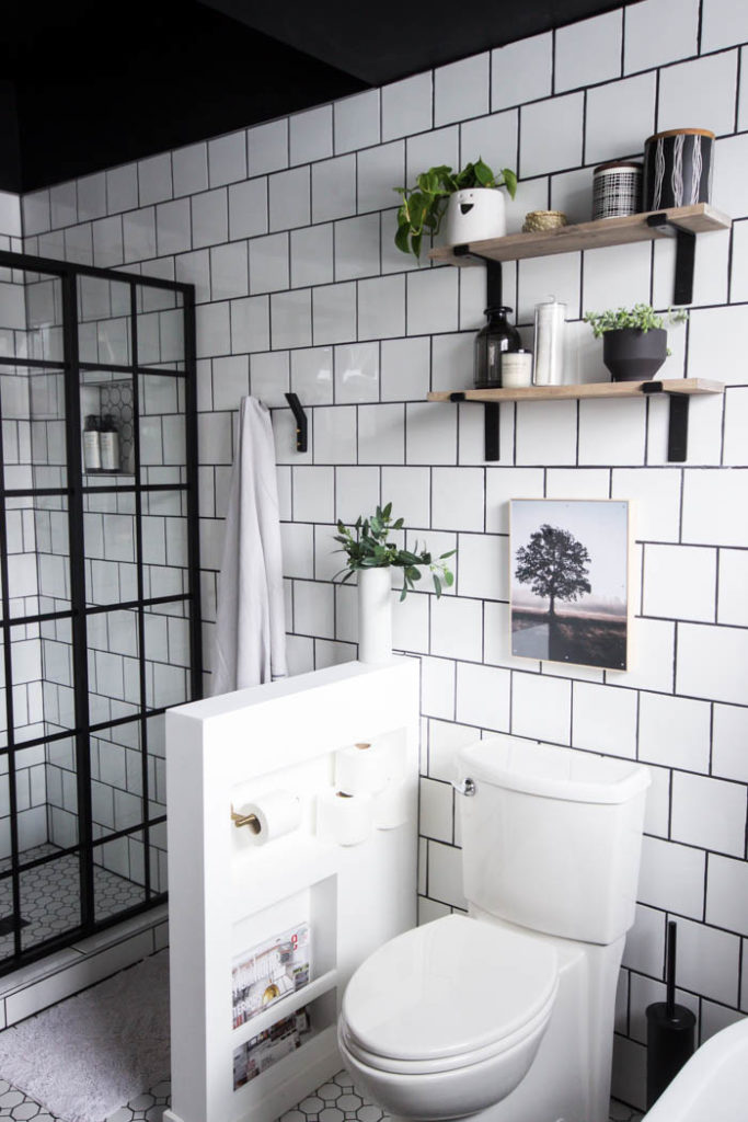 Love the look of this simple bathroom shelving! The open shelving is beautiful and so easy to build! Get tips and tricks for drilling into tile too! Love the modern bathroom design. #moderndesign #bathroom #DIY