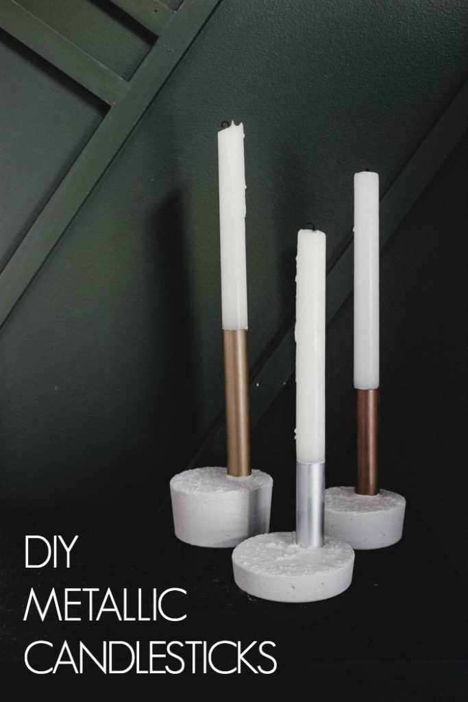Beautiful metallic candlesticks made with copper pipe, spray paint, and fast drying concrete mix! You'll love this quick and easy DIY project. It's the perfect modern gift idea! #concrete #copperpipe #moderndecor #industrialdecor #industrial #mixedmetals