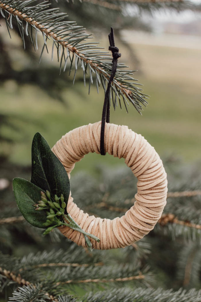 Beautiful mini wreath ornaments! These stylish leather ornaments are the perfect holiday accessory! Decorate your tree with this simple DIY Christmas craft! Perfect for modern, farmhouse, traditional, or any decor style! #Christmascraft #christmas #modernChristmas #holidaydecor #wreath
