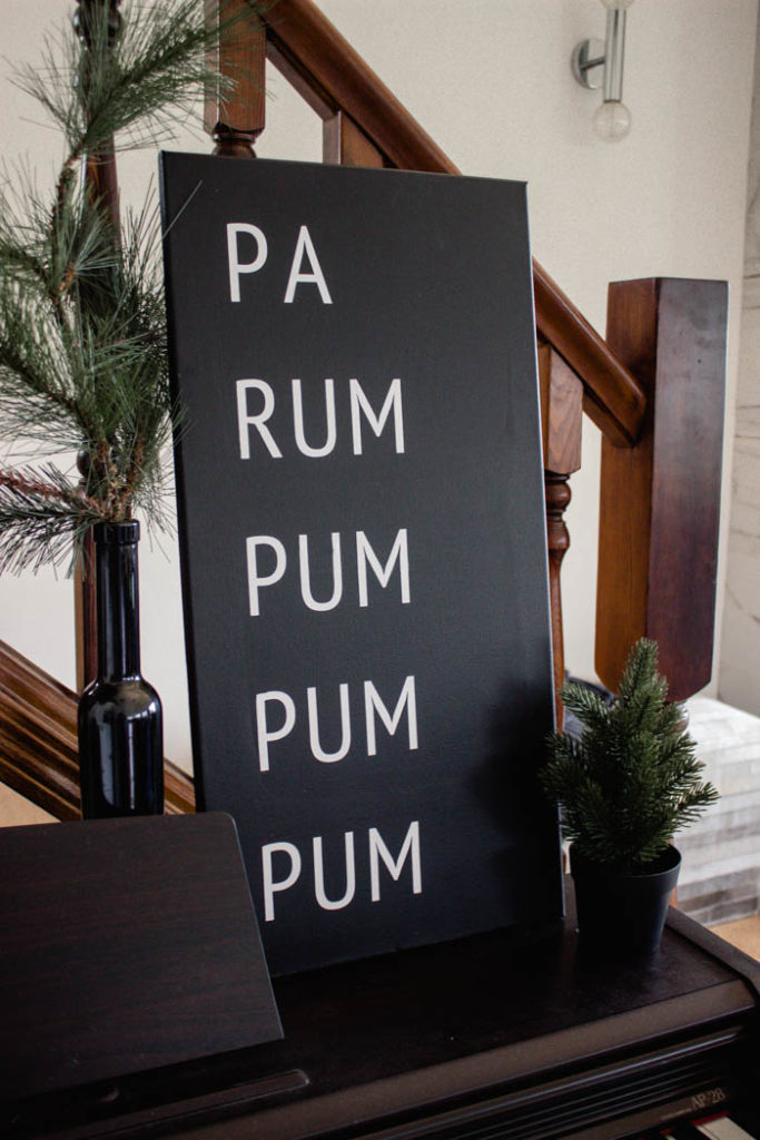 A beautiful Modern DIY sign for the holiday season! Love this simple Pa Rum Pum Pum Pum Christmas sign! What a fun way to share the song lyrics and decorate your home. #Christmas #holidaysign #DIYart #ModernChristmas #blackandwhite #homedecor