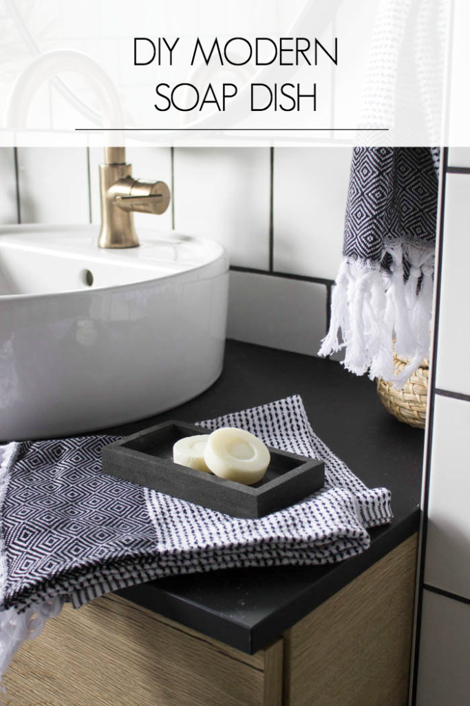 Sleek modern soap dish! Love this easy modern DIY using leftover tile! Love the chic and masculine feel to this modern DIY project on a budget. Looks amazing in this modern bathroom! #budgetfriendly #modernbathroom #basalt #leftovertile #makeover