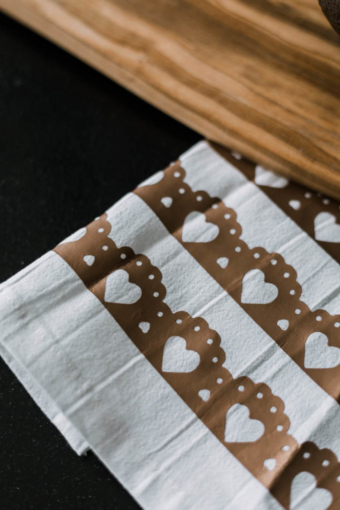 Martha Stewart projects in the design space. Easy Modern Valentine's Day Decor! Add a little love to your home with this easy DIY tea towel using the Cricut and iron-on vinyl or HTV. Love this subtle design and the modern take on Valentine's Day decor. #ValentinesDay #moderndecor #modernvalentinesday #diy #irononvinyl #cricutmade #cricutmarthastewart #cricut