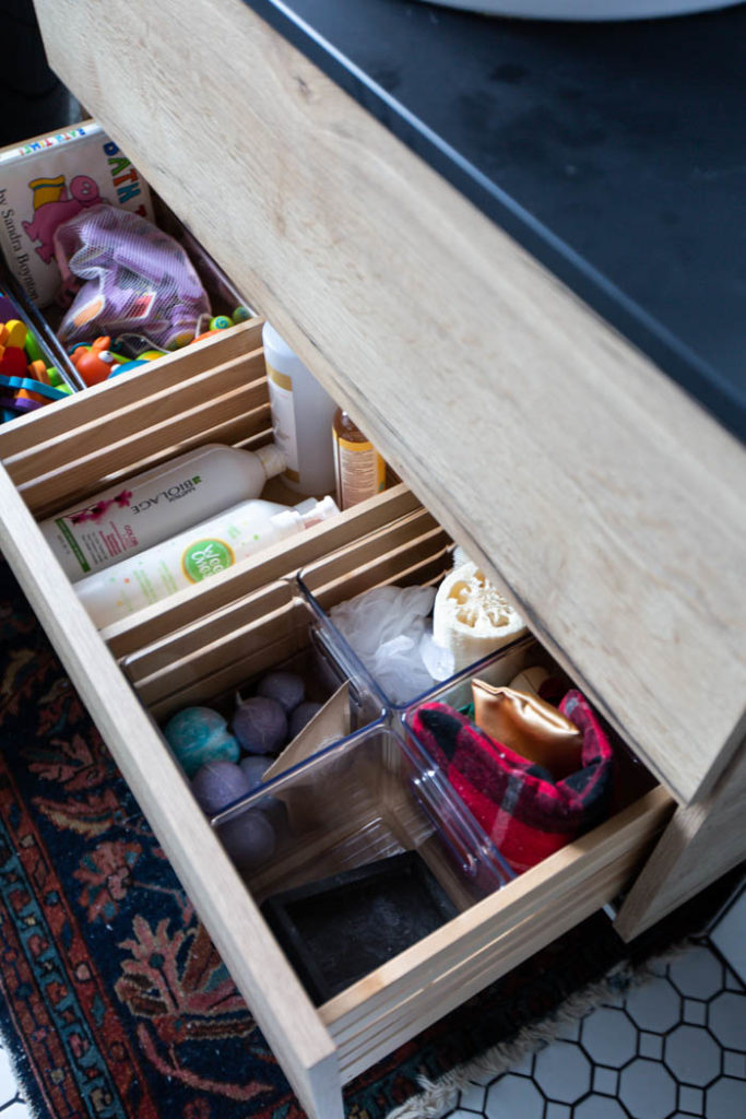Beautifully organized bathroom & storage for bath toys and accessories! Love these 5 great tips for organizing your drawers. So many practical and functional ideas for how to organize with just a few items. Beautiful stylish organization! #organization #bathroomorganization #modernbathroom #homeorganization