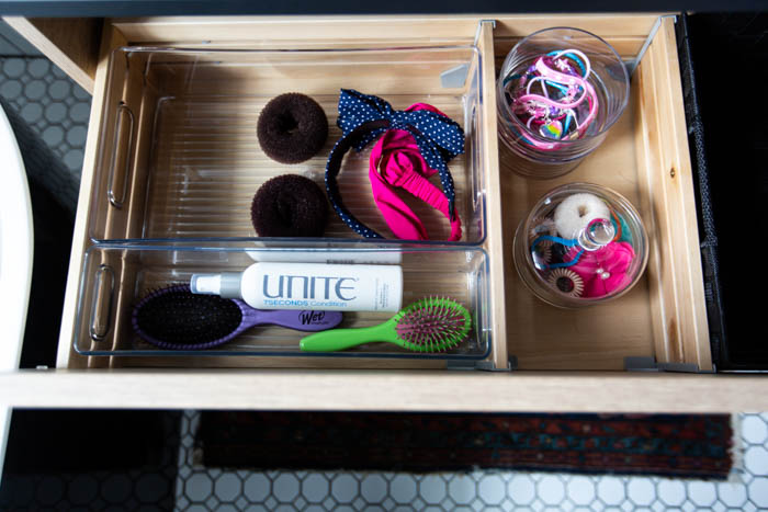 Beautifully organized bathroom supplies and hair accessories! Love these 5 great tips for organizing your drawers. So many practical and functional ideas for how to organize with just a few items. Beautiful stylish organization! #organization #bathroomorganization #modernbathroom #homeorganization