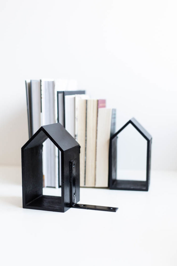 Black bookends full of books