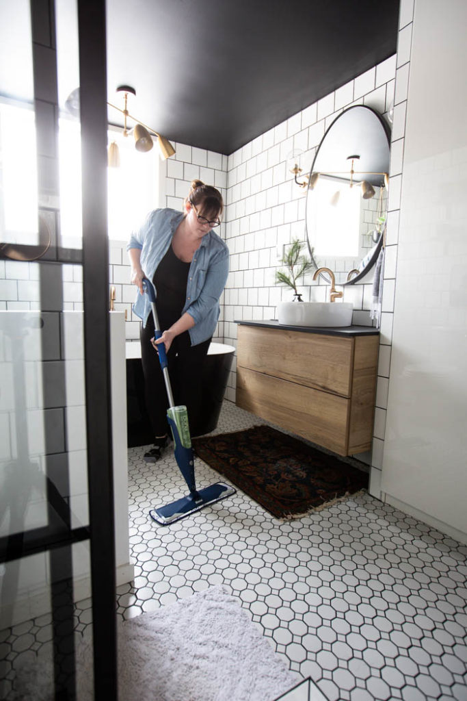 cleaning beautiful bathroom tiles