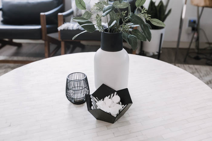 decorative candle, vase, and geometric bowl on coffee table