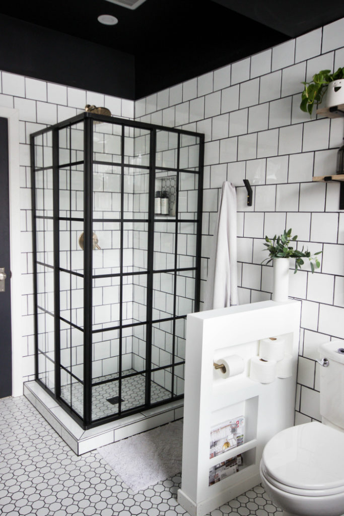 Modern bathroom featuring glass shower enclosure