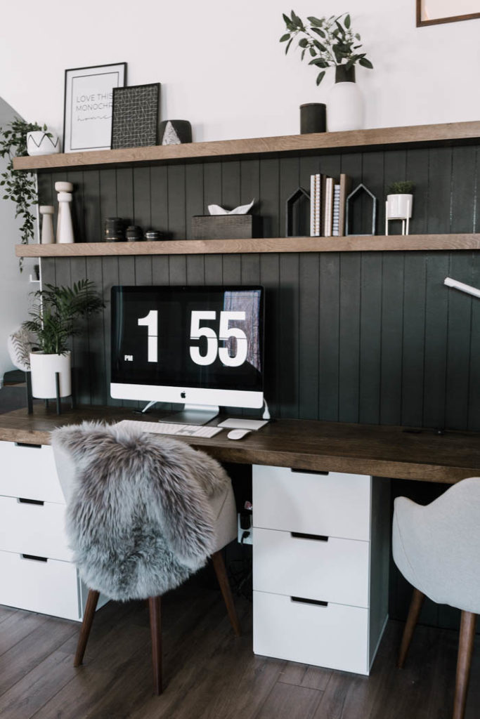 beautiful modern desk space with dark shiplap and brown desk and floating shelves