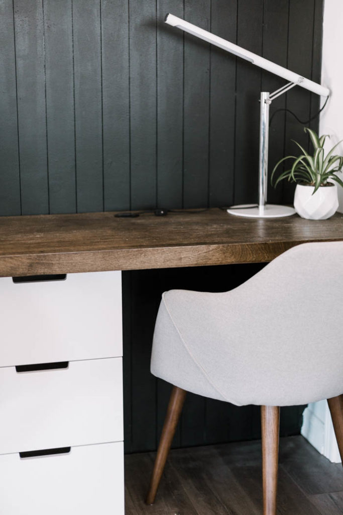 black vertical shiplap behind desk