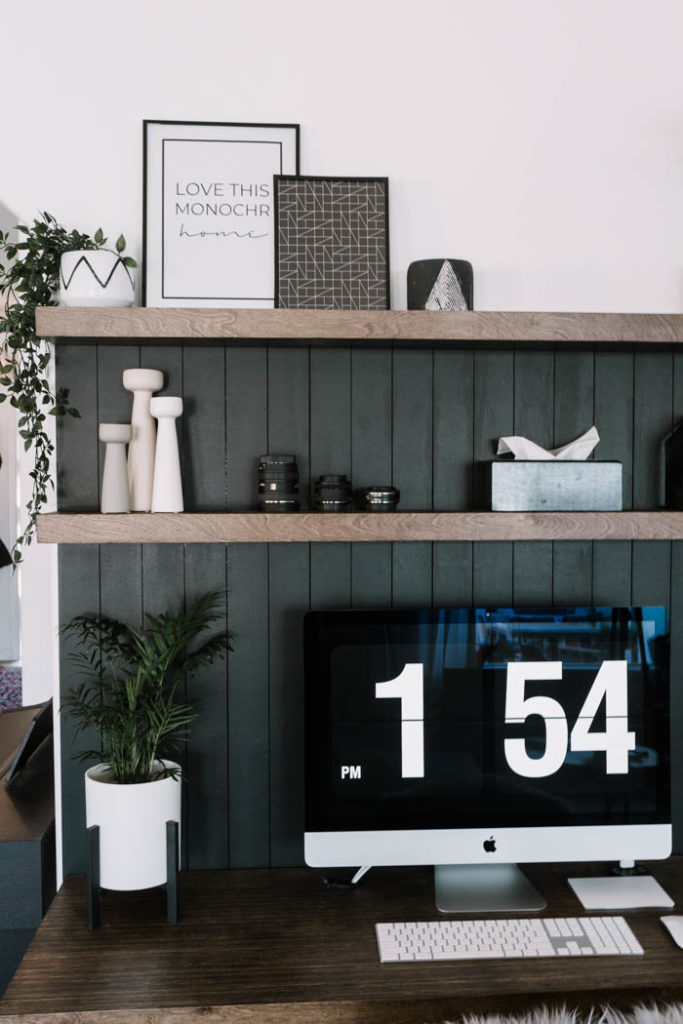black shiplap wall behind desk