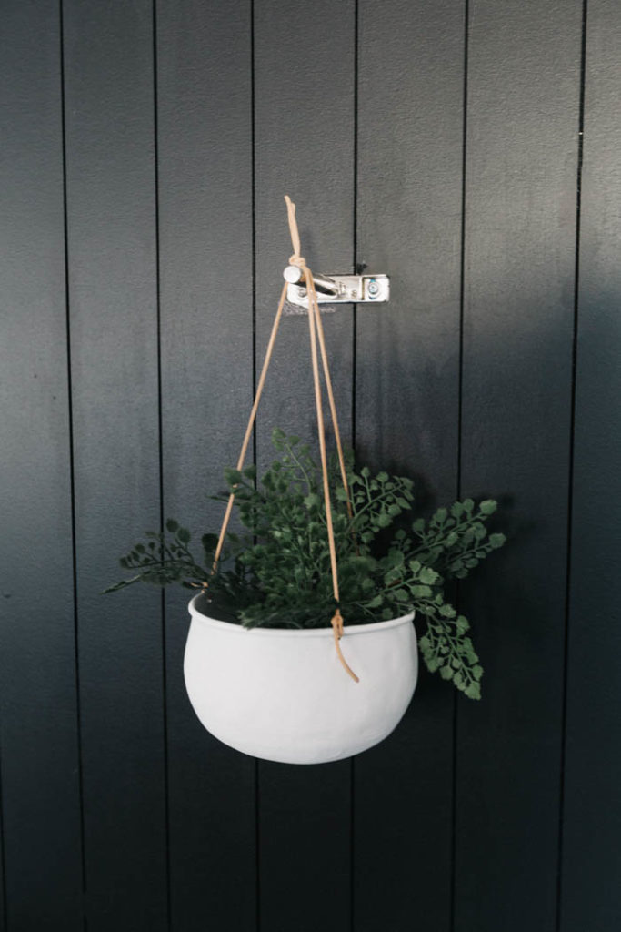 White hanging planter with leather cords