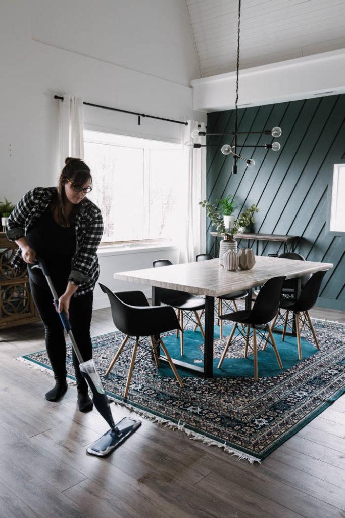 woman using Bona dust mop for laminate floors