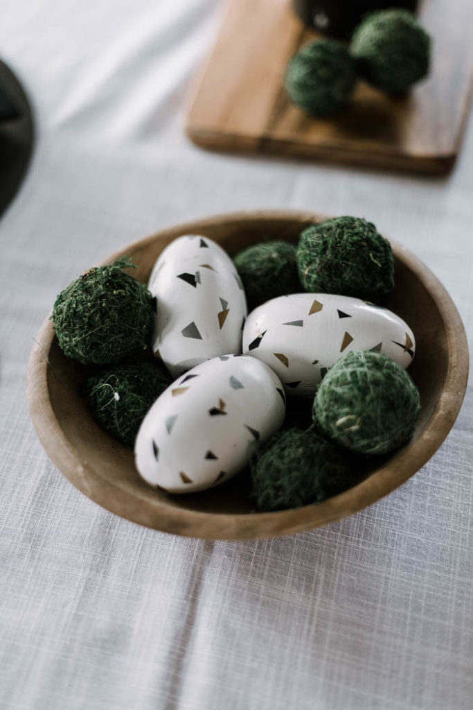 modern terrazzo easter eggs in a wooden bowl