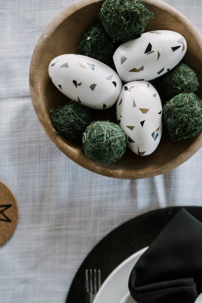 easter eggs and moss in a modern easter tablescape