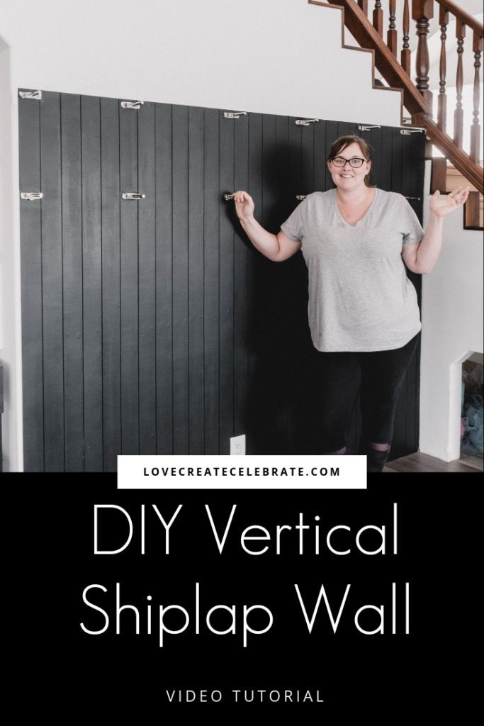"DIY modern black vertical shiplap wall with text overlay reading ""DIY vertical shiplap wall lovecreatecelebrate.com"""