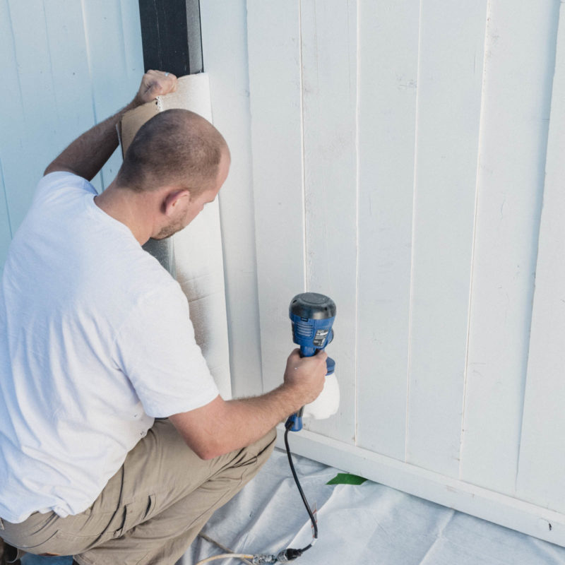 Showing how to paint a wood fence with a paint sprayer
