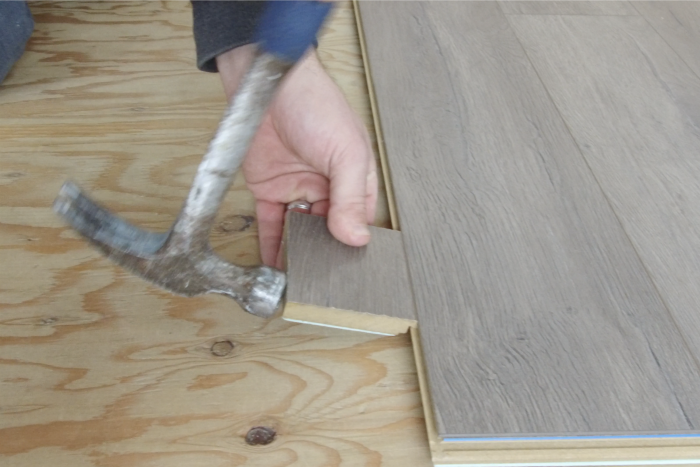 how to hammer laminate flooring in