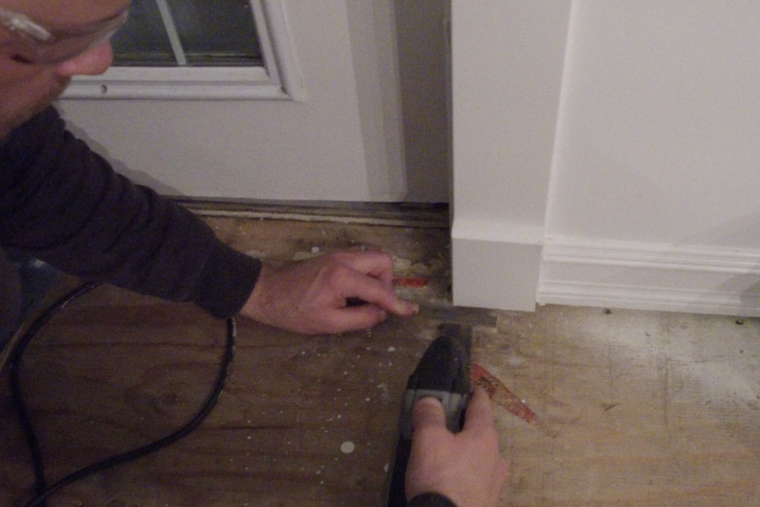 how to cut around mouldings and baseboards when laying laminate flooring