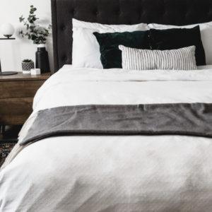 white linens on modern master bed