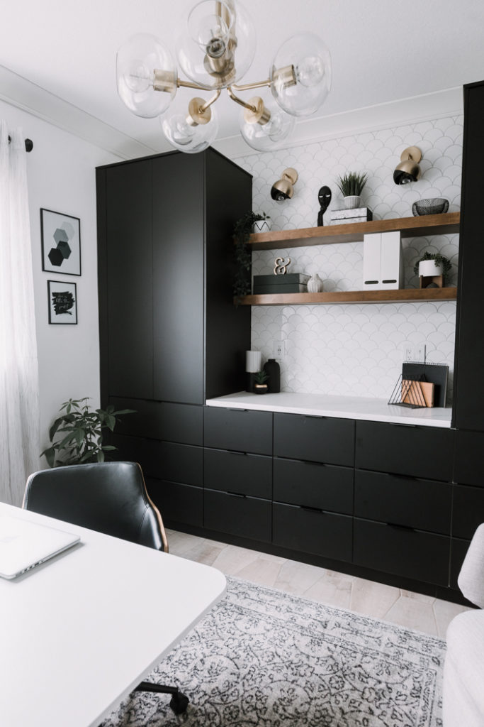 black cabinets in a stunning modern home office