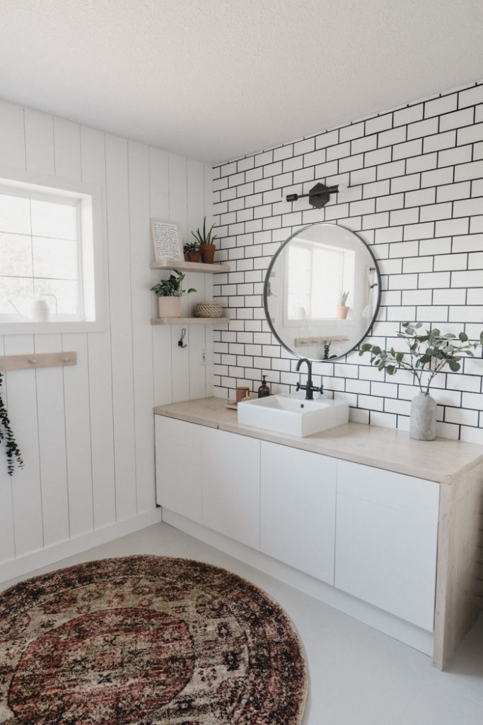 new tiled accent wall in white bathroom