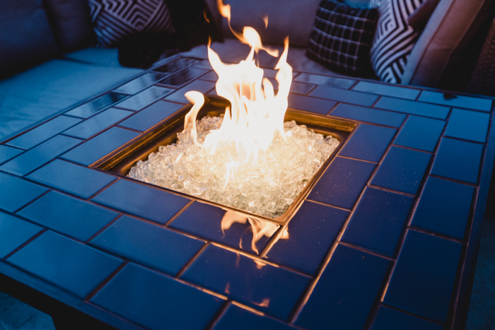 gorgeous black tile and white rock fire pit