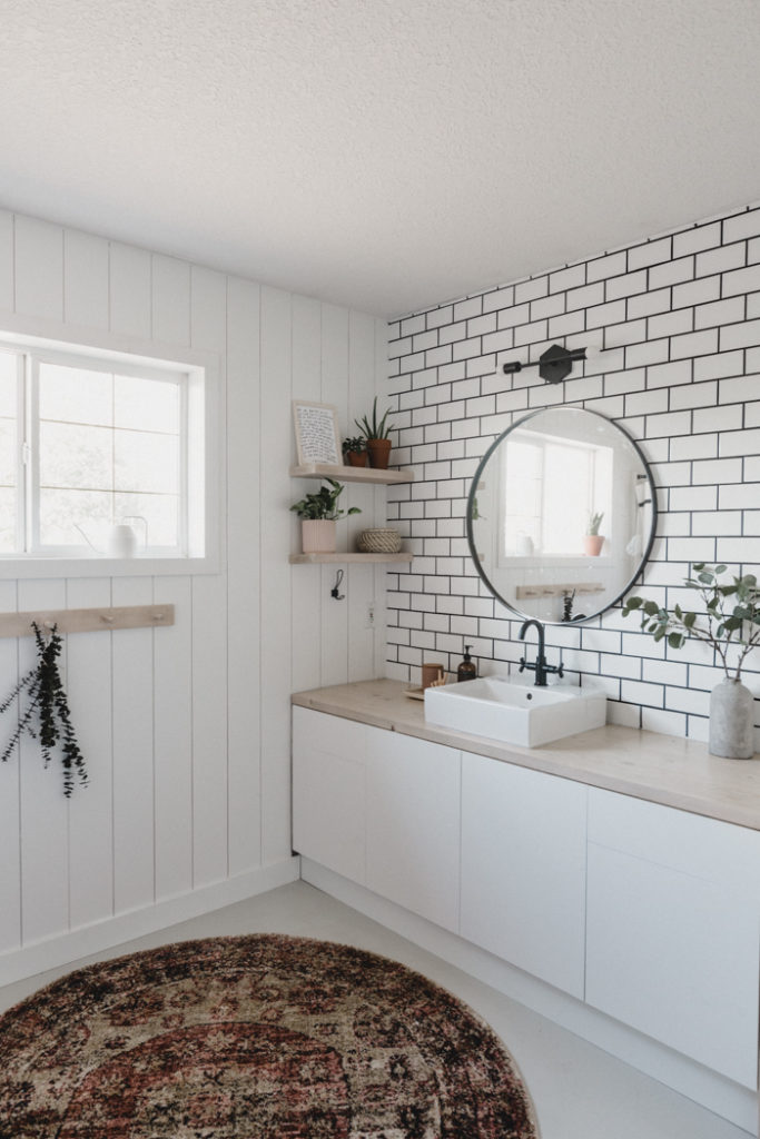 stunning bathroom with shiplap and tile wall