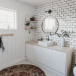 Tiled wall with subway tile in bathroom