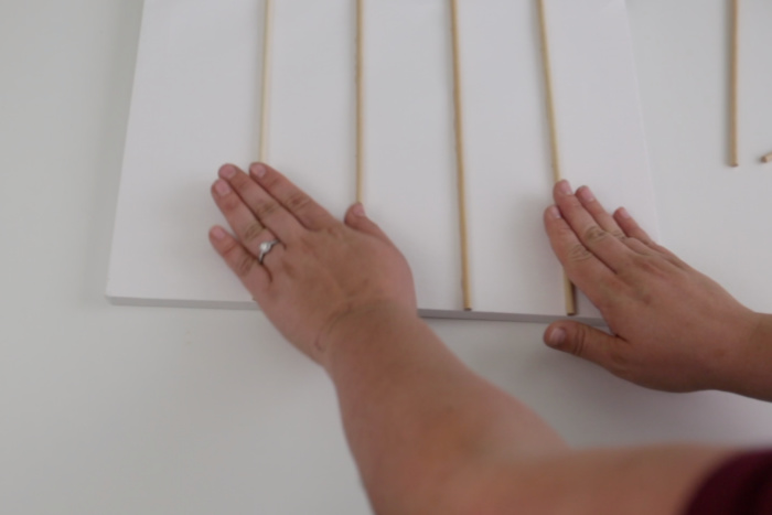 Gluing dowels to a canvas